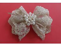 Beautiful lacey, bow shape, beads hair accessory for all occasions.