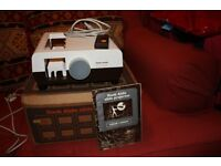 Rank Aldis Slide Projector in original packaging and in excellent condition.