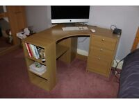 Corner desk with 3 drawers and shelving.