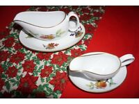 Royal Worcester Evesham Gold pair gravy jugs