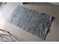 Woven grey and cream rug