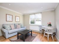 TR - A neutrally decorated one double bedroom flat in this private development