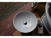 Round countertop basin, high rise mixer tap and toilet