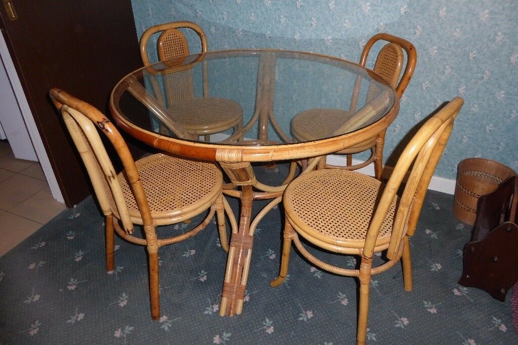 WICKER RATTAN GLASS TOPPED CIRCULAR TABLE AND FOUR MATCHING CHAIRS