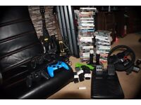 PS3 full package (Chair, Console, Active controllers, Steering Wheel and Pedals)