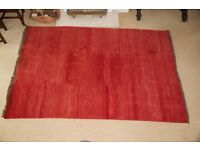 Woollen Large red fringed rug