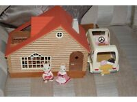 Sylvanian Families Dolls House with some furniture and 2 figures and ice cream van