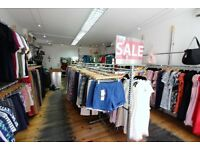 Running Business of clothing on main the Broadway with very low premium and rent --Crouch End --