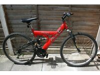 Gents mountain bike/Pagan Suspension/Red colour/Used/In reasonable condition/Good working order