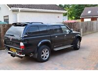 Mitsubishi L200 Animal double cab with full length lockable top .