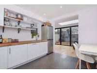A BEAUTIFULLY PRESENTED TWO DOUBLE BEDROOM CONVERSION WITH PRIVATE GARDEN ON FONTARABIA ROAD