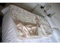 Pair of beige curtains with tie backs
