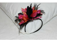 Fascinator with coloured feathers