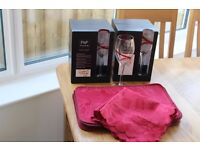 A set of Glasses, placemats and napkins for sale.