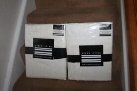 Brand new cream ready made curtains (116 width x 182cm drop)
