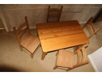 Table and 4 chairs (pine)