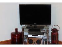 """37"""" Samsung tv and stand."""
