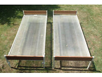 Twin single beds for sale. One slides under the other.