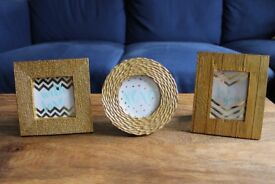 Set of three small gold picture frames. Square, round, and rectangle. Like new condition.