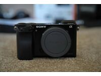 Sony A6000 - APS-C Mirrorless Camera with accessories.