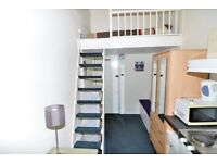 A nice, mezzanine bedsit room in Kensington W8, seconds from the Tube station