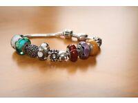 Genuine Pandora Bracelet with 11 genuine charms.