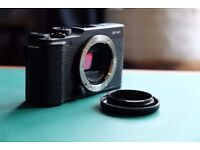 Fuji X-M1 Camera body with XC 16-50mm lens