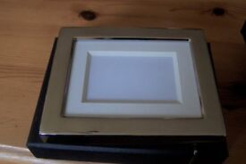 Two small Boxed silver photo frames
