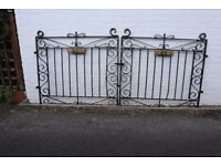 Pair of used gates with hinges approximately 2.5 metres wide