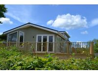 Investment opportunity, 2 bedroom lodge complete with large wrap around decking. Can be let out .
