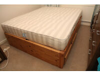 Solid pine King Size bed and mattress. Space saving design. Used but in very good condition