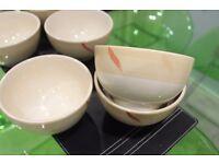 26 piece Beige / cream dinnerware with red & dark beige pattern on the rim.