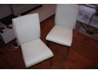 Four simple faux leather and chrome chairs - great for christmas extras