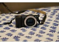 Sony Alpha 5000 (a5000) body with leather case and SD card