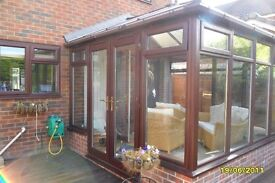 upvc conservatory approximately 3.2M x 3.2M brown three sided