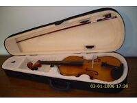 Wonderful Violin and Bow in black fitted case. Case with shoulder straps and music holder.
