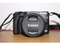 Canon EOS M3 with 18-55mm lens and accessories