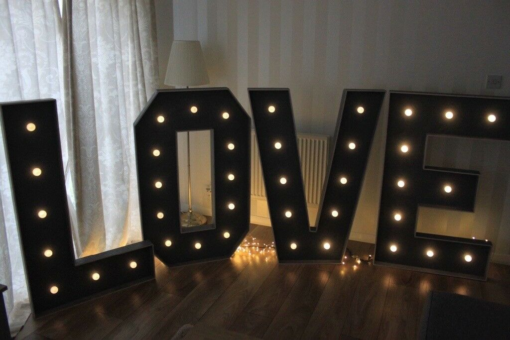 4ft tall light up LOVE letters to hire. Rustic / shabby chic wedding prop hire. Battery powered.