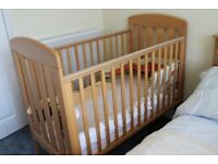 Mamas and Papas oak cot, good condition, used only at Grandparents house. All sides slatted