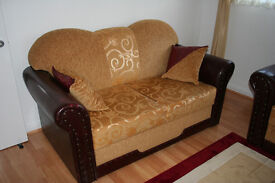 2 seating sofa with hidden draw very good condition