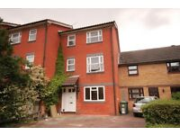A spacious 4 bedroom 3 storey townhouse located in a gated development in Surrey Quays.