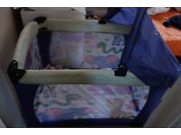 Baby space saver travel cot with near new mattress