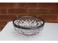 Cut glass bowl with silver coloured rim