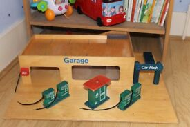 Traditional wooden garage, very sturdy, shows signs of use but still a brilliant solid toy.