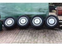 4 BMW ALLOY WHEELS WITH TYRES.