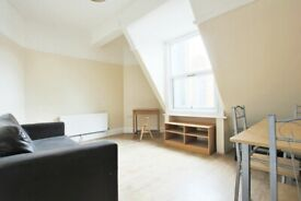 Aldgate flat of a character building, with a roof terrace