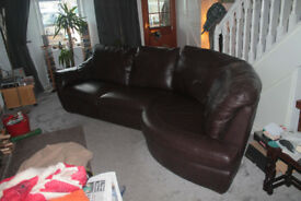 Brown leather corner sofa in good condition with fire safety label