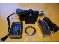 panasonic LX7 high end compact camera, excellent in low light (F1.4) and for close-ups (1cm)