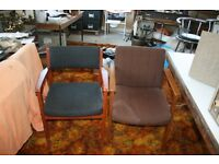 Two upholstered office chairs in reasonable condition.