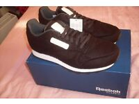 New Reebok Classic Trainers boxed. Unworn. Size 9. Black / White. Horse Hair material.
